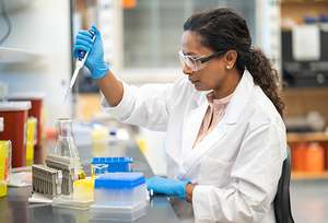 Scientist-pipetting-in-lab